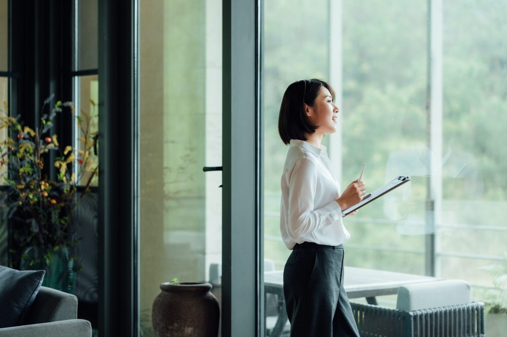 Asian businesswoman at office window